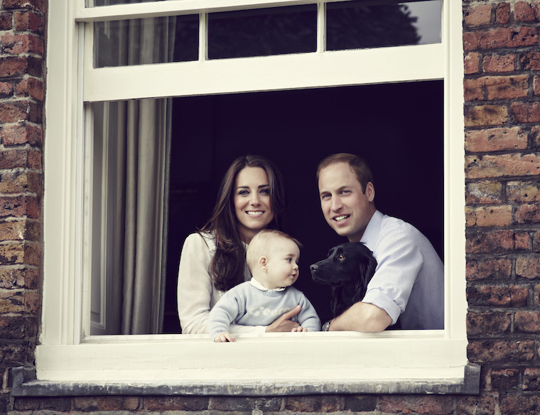 The Duke and Duchess of Cambridge with their son Prince George photographed at Kensington Palace, March 2014. Also pictured their dog Lupo. Usage terms: This photograph is strictly for editorial use only, no commercial,souvenir or promotional use permitted. The photograph cannot be cropped, manipulated or altered. OBLIGATORY CREDIT LINE © JASON BELL/CAMERA PRESS/REDUX.